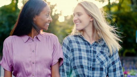 Tracking-Shot-of-Female-Couple-Laughing-and-Walking-Together