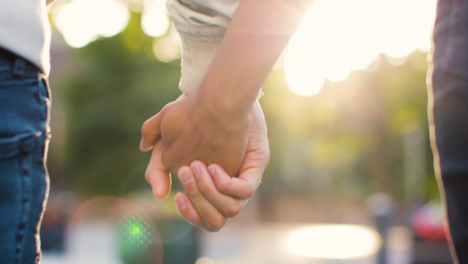 Extreme-Close-Up-of-Couple-Holding-Hands