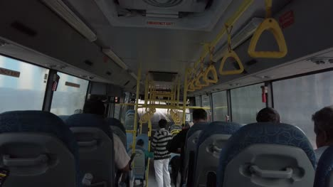 Bengaluru-Karnataka-India-Wide-angle-shot-of-the-inside-of-a-public-bus-during-day-time-less-crowded-due-to-corona-virus-fear