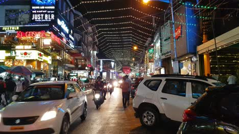 Bengaluru-Karnataka-India-October-26-2019-Wide-angle-view-of-the-lighting-decorations-in-Brigade-road-on-the-occasion-of-Diwali-festival-celebrations-and-vehicles-driving-through-the-road