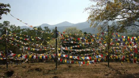 Beautiful-shot-of-colorful-Buddhist-flags-fluttering-in-wind-on-rope-during-a-bright-sunny-day