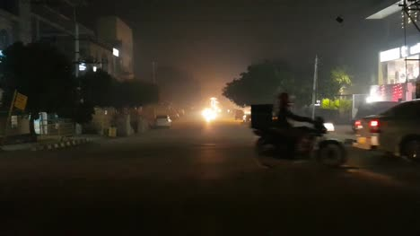 BANGALORE-KARNATAKA-INDIA-OCTOBER-19-2017-People-driving-slowly-due-to-smoke-and-less-visibility-caused-by-bursting-crackers-during-Diwali-celebrations