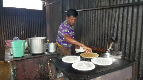 Chennai-Tamilnadu-India-July-29-2019-A-man-making-dosa-(Indian-Pancake)-in-a-road-side-shop