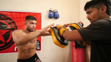 Bengaluru-Karnataka-India-February-13-2020-Close-up-of-two-mixed-martial-arts-fighters-practicing-elbow-shots-inside-a-dojo-during-day-time