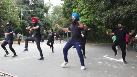Bengaluru-Karnataka-India-September-1-2019-Slow-motion-shot-of-a-Punjabi-flash-mob-perfroming-bhangra-dancing-to-a-song-in-Cubbon-park-on-a-bright-day