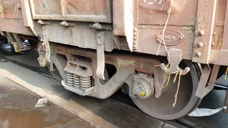 Closeup-view-of-the-wheels-of-a-goods-train