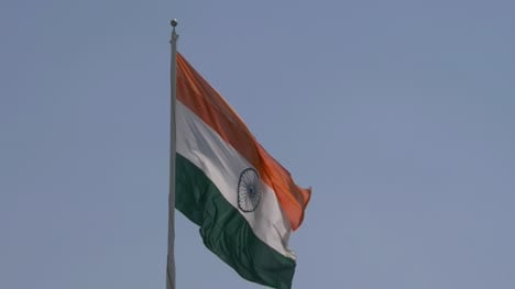 Close-up-of-giant-Indian-flag-fluttering-in-heavy-wind