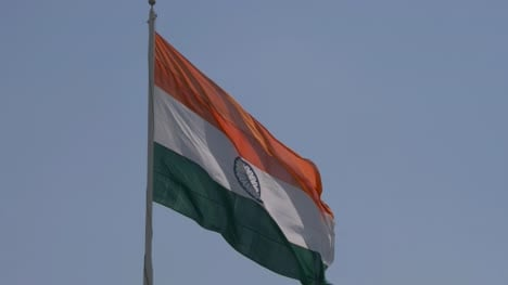 Close-up-view-of-giant-Indian-flag-fluttering-in-wind