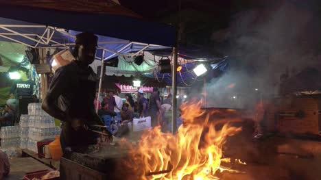 Bengaluru-Karnataka-/-India---May-26-2019:-A-man-preparing-stakes-on-a-rock-slab-at-a-road-side-shop-in-Bengaluru-during-Ramzan-festival
