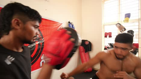 Bengaluru-Karnataka-/-India---February-13-2020:-Close-up-of-two-mixed-martial-arts-fighters-practicing-elbow-shots-inside-a-dojo-during-day-time