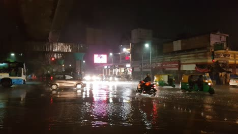 Bengaluru-Karnataka-/-India---May-26-2019:-Vehicles-passing-through-MG-road-junction-during-heavy-rain-and-flooding