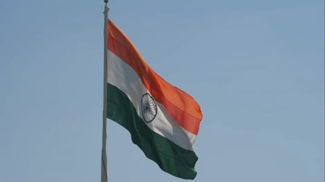 Close-up-view-of-a-giant-Indian-flag-fluttering-in-heavy-wind