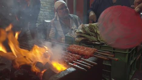 Bengaluru-Karnataka-India-May-26-2019-A-man-preparing-meat-skewers-at-a-road-side-shop-in-Bengaluru-during-Ramzan-festival