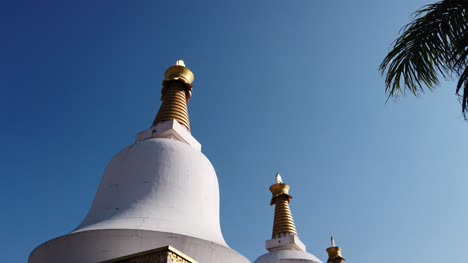 Kollegal-Karnataka-India-Wide-angle-tilt-down-job-shot-of-Buddhist-prayer-Stupas-at-the-Dhondenling-monastery-on-a-bright-sunny-day