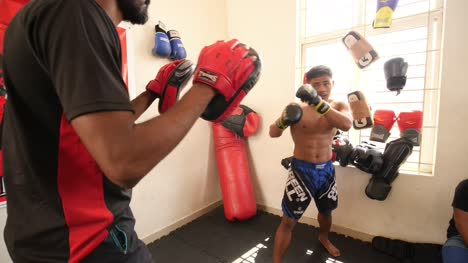 Bengaluru-Karnataka-India-February-13-2020-Two-adult-men-training-in-mixed-martial-arts-and-one-fighter-takes-down-the-other-to-the-ground