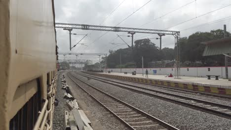 Vaniyambadi-Tamilnadu-India-December-14-2019-View-from-the-window-of-a-interstate-train-entering-a-railway-station-on-an-overcast-day