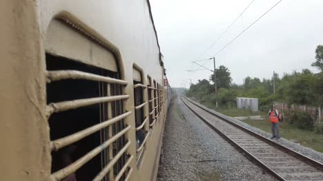Aambur-Tamilnadu-India-December-14-2019-View-from-the-window-of-a-interstate-train-travelling-at-high-speed-on-a-straight-track-on-an-overcast-day