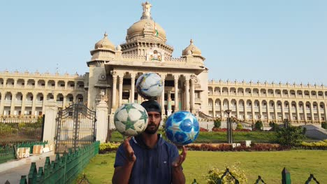 Bengaluru-Karnataka-India-10Mar2019-An-artist-performing-tricks-with-footballs-in-front-of-Vidhana-Soudha-building-in-Bengaluru-Karnataka-India-during-early-morning