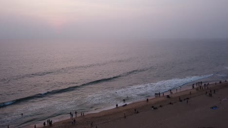 Wide-angle-panning-shot-of-the-beautiful-Cliff-beach-in-Kerala-during-sunset