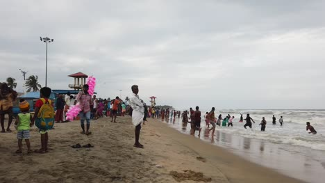 Velankanni-Tamilnadu-India-December-07-2019-Stop-motion-video-of-the-the-tourists-enjoying-at-a-crowded-beach-on-an-overcast-day