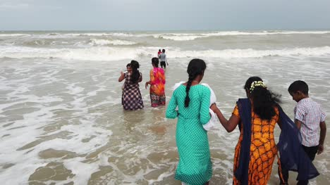 Velankanni-Tamilnadu-India-December-07-2019-Panning-shot-of-the-tourists-enjoying-at-the-beach-on-an-overcast-day