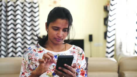 Closeup-of-an-young-Indian-woman-operating-a-mobile-phone-