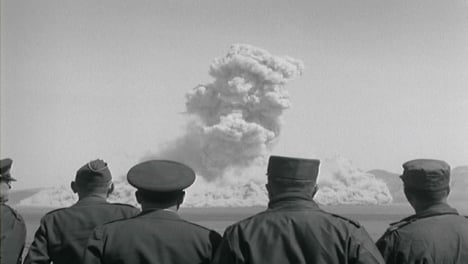 1950s-American-Military-Personnel-Observing-Nuclear-Bomb-Test-From-Distance