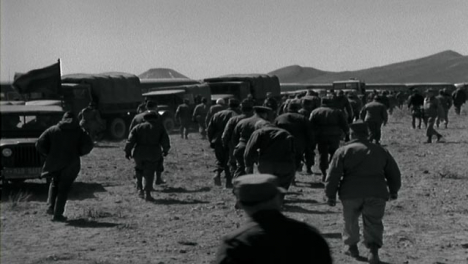 1955-American-Military-Personnel-Walking-to-Transport-Vehicles-In-the-Desert-
