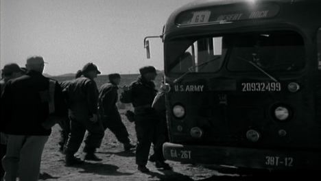 1955-American-Military-Personnel-Boarding-Transport-Vehicles-In-the-Desert-