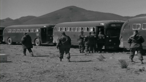 1955-American-Military-Personnel-Boarding-Vehicles-In-the-Desert-