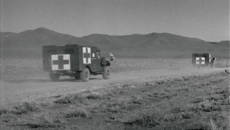 1950s-Vehicles-Driving-to-Test-Site-During-American-Nuclear-Exercise
