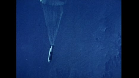 Archive-Clip-of-Hydrogen-Bomb-Falling-From-Plane-and-Deploying-Parachute