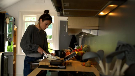 Young-Woman-Dicing-a-White-Onion-
