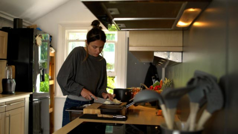 Young-Woman-Dicing-White-Onion-