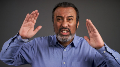 Visibly-Angry-Middle-Aged-Man-Shouting-Portrait