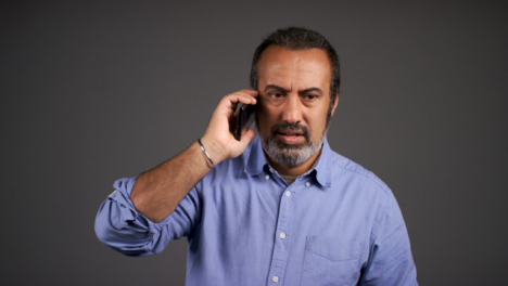 Middle-Aged-Man-Receives-Bad-News-Over-Phone