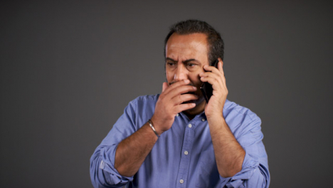 Middle-Aged-Man-Receives-Bad-News-Over-Phone-Portrait