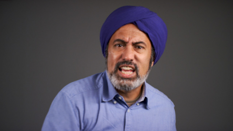 Frustrated-Middle-Aged-Man-In-Turban-Shouting-Portrait