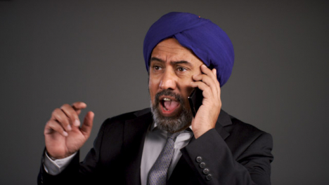 Frustrated-Middle-Aged-Businessman-In-Turban-Shouting-On-Phone