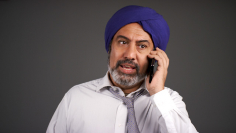 Smart-Annoyed-Middle-Aged-Man-In-Turban-Shouting-On-Phone