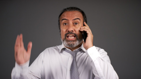Smart-Frustrated-Middle-Aged-Man-Shouting-On-Phone-Portrait