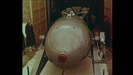 1956-Soviet-Atomic-Bomb-Being-Loaded-Onto-Plane