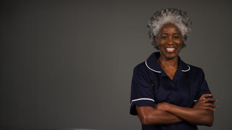 Middle-Aged-Nurse-Folding-Arms-and-Smiling-