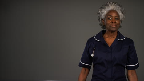 Middle-Aged-Nurse-Folds-Her-Arms-and-Smiles