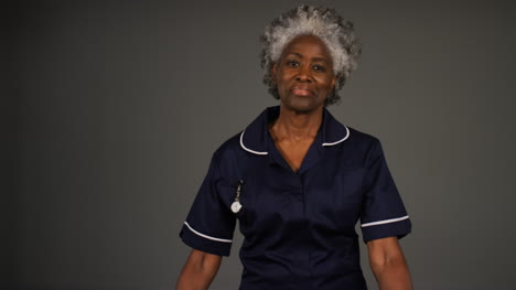Middle-Aged-Nurse-Folds-Her-Arms-and-Smiles-Portrait
