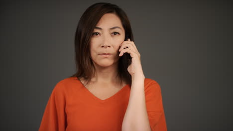 Middle-Aged-Woman-Recieves-Bad-News-Over-Phone-Portrait