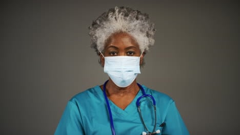Middle-Aged-Doctor-Wearing-Face-Mask-Portrait