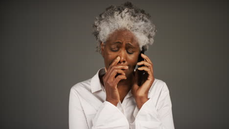 Smartly-Dressed-Woman-Receiving-Bad-News-On-Phone-Portrait