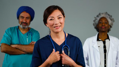 Three-Approachable-Medical-Professionals-Smiling-Portrait