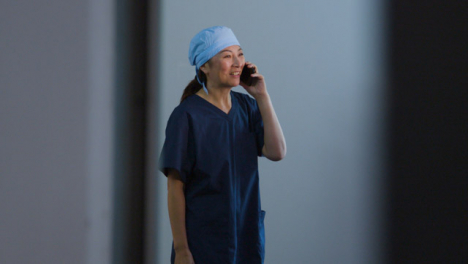 Middle-Aged-Surgeon-Talking-On-Her-Mobile-Phone